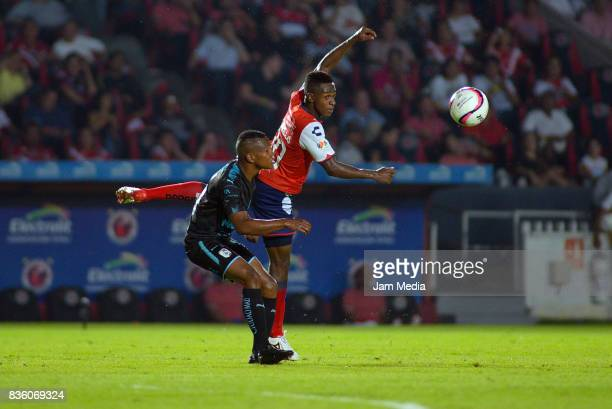 Ricardo Diaz of Queretaro and Jefferson Murillo Aguilar of Veracruz fight for the ball during the fifth round match between Veracruz and Queretaro as...