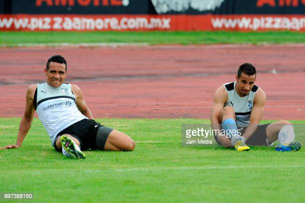 Ricardo Esqueda and Camilo Sanvezzo of Queretaro stretch during the Pre Season training match for the Torneo Apertura 2017 Liga MX between Atlante...