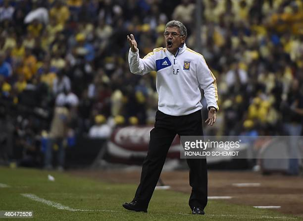 Ricardo Ferretti coach of Tigres gicves instructions to his players during the Mexican Apertura tournament second leg final football match against...