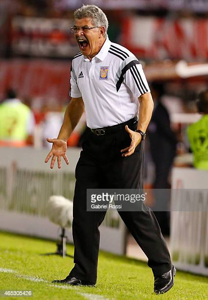Ricardo Ferretti coach of Tigres gives instructions to his players during a match between River Plate and Tigres as part of second round of Group 6...