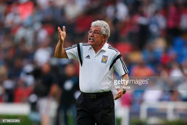 Ricardo Ferretti coach of Tigres gives instructions to his players during a match between Queretaro against Tigres as part of the Clausura Tournament...