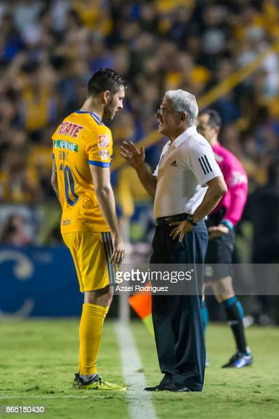 Ricardo Ferretti coach of Tigres talks to AndrePierre Gignac during the 14th round match between Tigres UANL and Toluca as part of the Torneo...