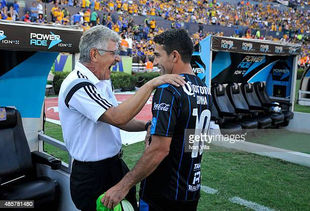 Ricardo Ferretti coach of Tigres talks to Antonio Naelson of Queretaro during a 7th round match between Tigres UANL and Queretaro as part of the...