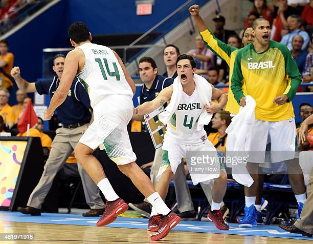 Ricardo Fischer of Brazil celebrates a basket by Leonardo Meindl of Brazil on their way to a gold medal with a 8671 victory over Canada in men's...