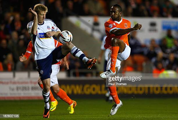 Ricardo Fuller of Blackpool in action with Tim Ream of Bolton during the Sky Bet Championship match between Blackpool and Bolton Wanderers at...