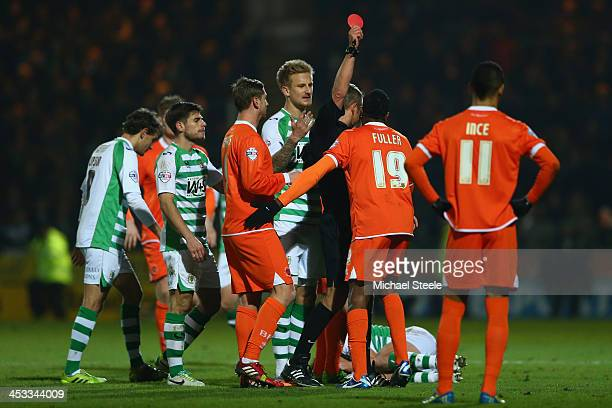 Ricardo Fuller of Blackpool is shown a red card by referee Christopher Sarginson after head butting Luke Ayling of Yeovil Town during the Sky Bet...