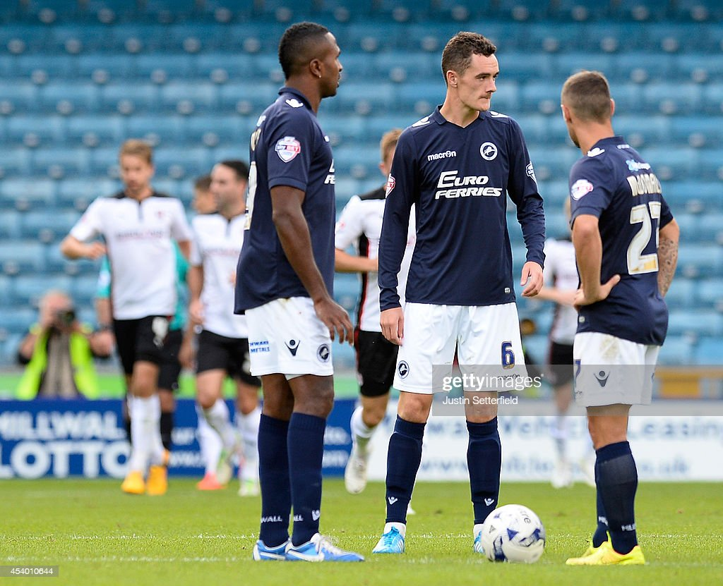 Ricardo Fuller of Millwall FC Shaun Williams of Millwall FC and Scott McDonald of Millwall FC look dejected as Rotherham United celebrate scoring the...