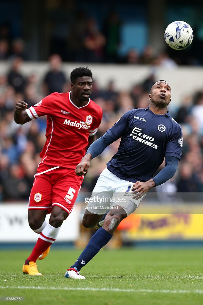 <a gi-track='captionPersonalityLinkClicked' href=/galleries/search?phrase=Ricardo+Fuller&family=editorial&specificpeople=240619 ng-click='$event.stopPropagation()'>Ricardo Fuller</a> of Millwall watches the ball over his head under pressure by <a gi-track='captionPersonalityLinkClicked' href=/galleries/search?phrase=Bruno+Ecuele+Manga&family=editorial&specificpeople=7115761 ng-click='$event.stopPropagation()'>Bruno Ecuele Manga</a> of Cardiff during the Sky Bet Championship match between Millwall and Cardiff City at The Den on October 25, 2014 in London, England.