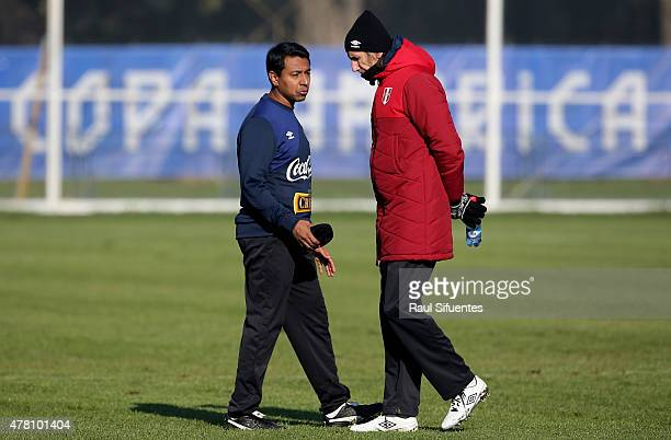 Ricardo Gareca coach of Peru talks with his assistant Norberto Solano during a training match against a local youth team of Universidad de La...