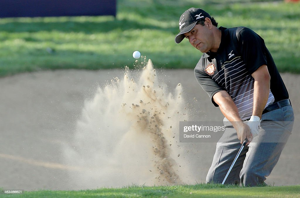 <a gi-track='captionPersonalityLinkClicked' href=/galleries/search?phrase=Ricardo+Gonzalez&family=editorial&specificpeople=240556 ng-click='$event.stopPropagation()'>Ricardo Gonzalez</a> of Argentina plays his second shot at the par 3, 15th hole during the third round of the 2014 Abu Dhabi HSBC Golf Championship at Abu Dhabi Golf Club on January 18, 2014 in Abu Dhabi, United Arab Emirates.