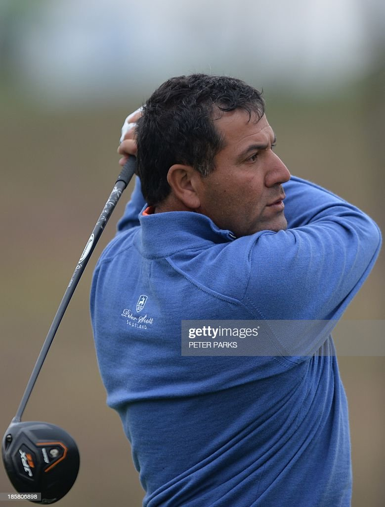 Ricardo Gonzalez of Argentina tees off at the 18th hole during the second round of the BMW Shanghai Masters golf tournament at the Lake Malaren Golf Club in Shanghai on October 25, 2013. AFP PHOTO/Peter PARKS