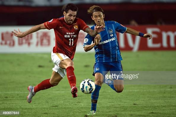 Ricardo Goulart of China's Guangzhou Evergrande tussles for the ball against Usami Takashi of Japans Gamba Osaka during their AFC Champions League...