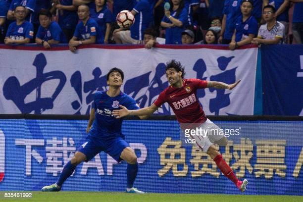 Ricardo Goulart of Guangzhou Evergrande and Kim KeeHee of Shanghai Shenhua head the ball during the 23rd round match of 2017 Chinese Football...