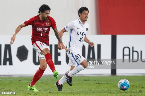 Ricardo Goulart of Guangzhou Evergrande and Mitsuo Ogasawara of Kashima Antlers vie for the ball during 2017 AFC Champions League eighthfinal match...