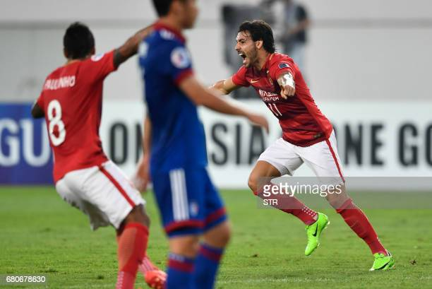Ricardo Goulart of Guangzhou Evergrande celebrates with teammate Paulinho after scoring against Suwon Samsung Bluewings during their AFC Champions...