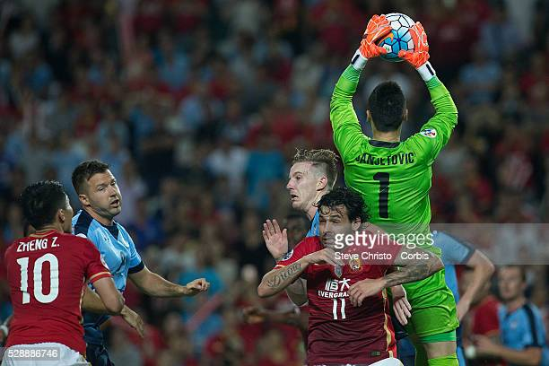 Ricardo Goulart of Guangzhou Evergrande misses a heading opportunity against Sydney FC's Vedran Janjetovic and Andrew Hoole in the AFC Champions...
