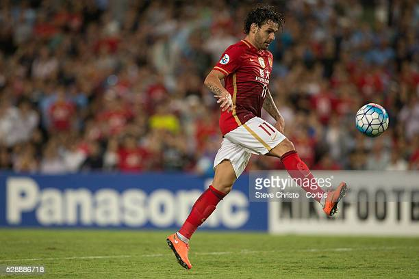 Ricardo Goulart of Guangzhou Evergrande tries to chip Sydney FC's goalkeeper Vedran Janjetovic but was called offside in the AFC Champions League...