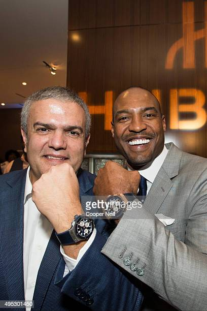 Ricardo Guadalupe and Darren Woodson pose for a photo as Hublot unveils the Big Bang Dallas Cowboys timepieces at ATT Stadium on November 1 2015 in...