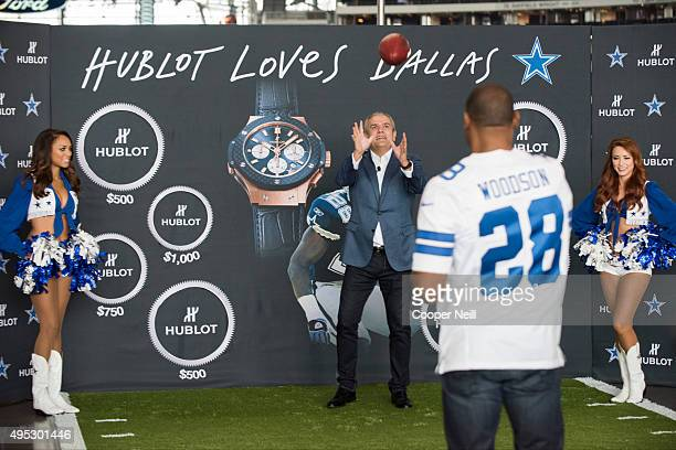 Ricardo Guadalupe and Darren Woodson throw a football as Hublot unveils the Big Bang Dallas Cowboys timepieces at ATT Stadium on November 1 2015 in...