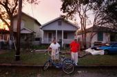 Ricardo Hernandez and Joe Gonzales chat out side Hernandez's flooddamaged home following Hurricane Ike September 13 2008 in Galveston Texas Ike made...