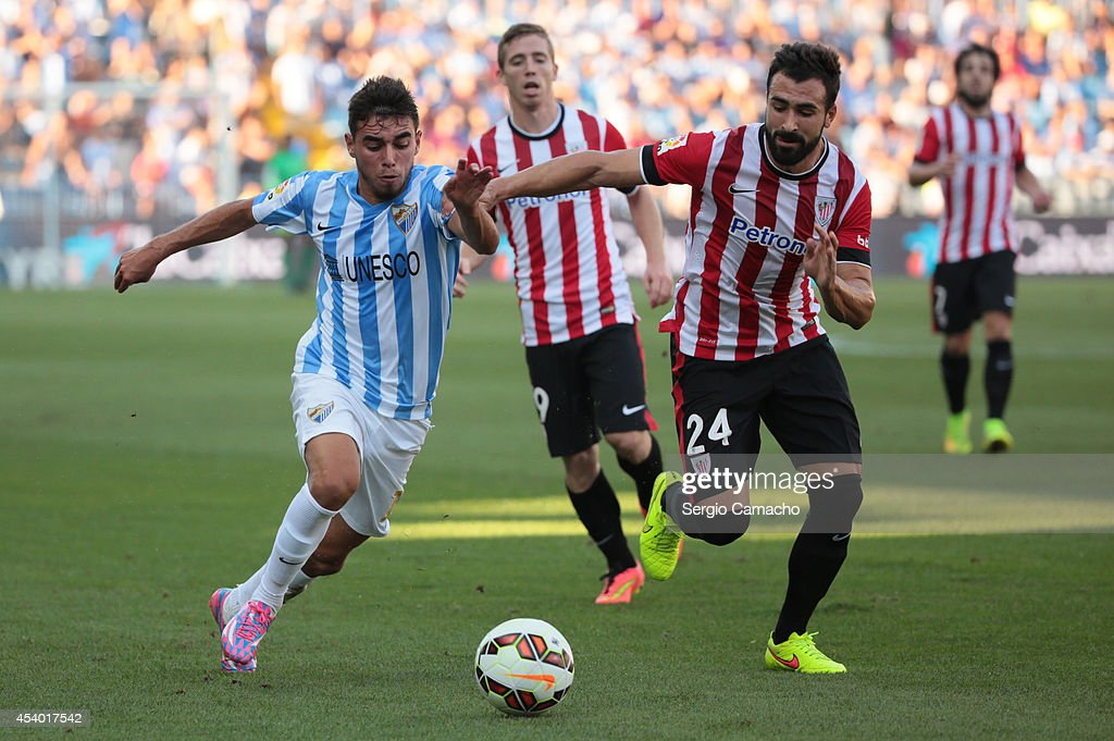 Ê Ricardo Horta of Malaga CF (L) duels for the ball with Balenziaga of Athletic Club Bilbao during the La Liga match between Malaga CF and Athletic Club Bilbao at La Rosaleda Stadium on August 23, 2014 in Malaga, Spain.Ê