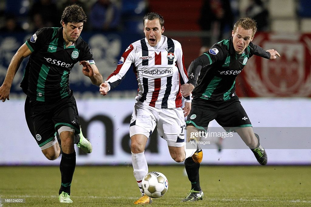 Ricardo Ippel of Willem II (C), Maikel Kieftenbeld of FC Groningen (R), Kees Kwakman of FC Groningen (L) during the Dutch Eredivisie match between Willem II and FC Groningen at the Koning Willem II Stadium on march 30, 2013 in Tilburg, The Netherlands
