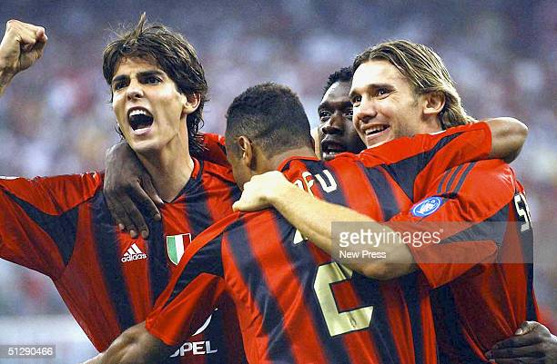 Ricardo Kaka and Andriy Shevchenko of Milan celebrate the goal of Clarence Seedorf during the Serie A match between AC Milan and Livorno at the San...