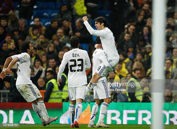 Ricardo Kaka celebrates with his team mates Cristiano Ronaldo Marcelo and Mesut Ozil during the La Liga match between Real Madrid and Villarreal at...