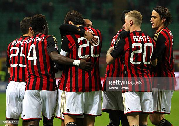 Ricardo Kaka of AC Milan celebrates with his teammates after scoring the opening goal during the Serie A match between AC Milan and Genoa CFC at...