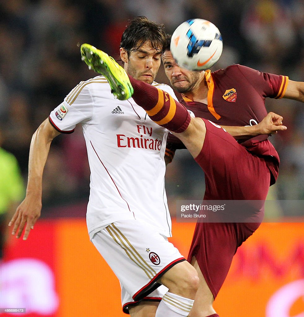 Ricardo Kaka' (L) of AC Milan competes for the ball with <a gi-track='captionPersonalityLinkClicked' href=/galleries/search?phrase=Leandro+Castan&family=editorial&specificpeople=5891971 ng-click='$event.stopPropagation()'>Leandro Castan</a> of AS Roma during the Serie A match between AS Roma and AC Milan at Stadio Olimpico on April 25, 2014 in Rome, Italy.