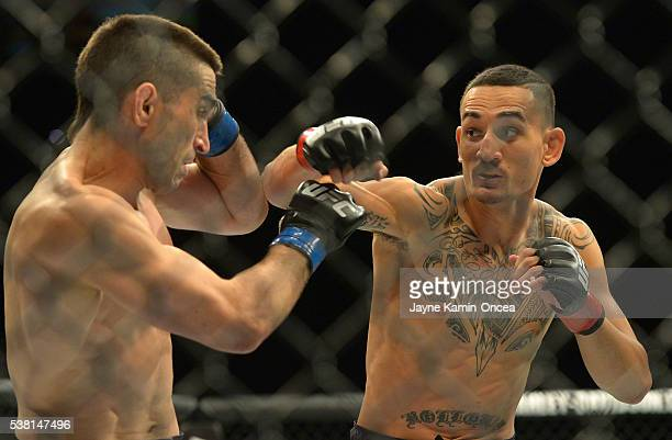 Ricardo Lamas and Max Holloway during their featherweight bout at UFC 199 at The Forum on June 4 2016 in Inglewood California