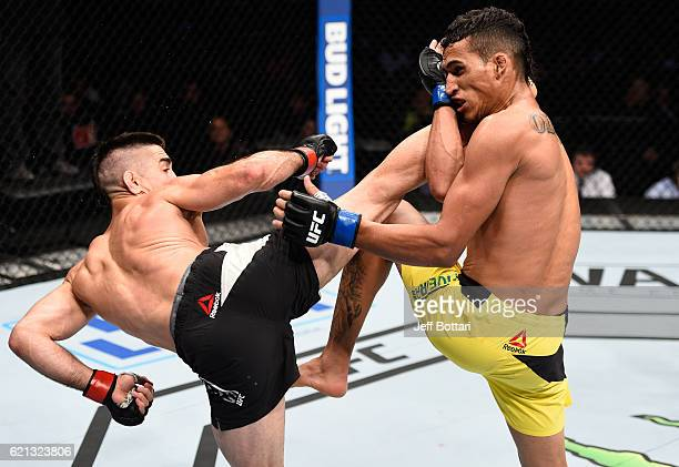 Ricardo Lamas of the United States kicks Charles Oliveira of Brazil in their featherweight bout during the UFC Fight Night event at Arena Ciudad de...