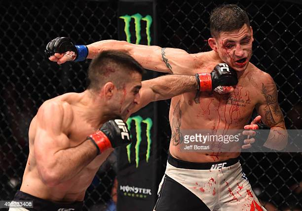 Ricardo Lamas of the United States punches Diego Sanchez of the United States in their featherweight bout during the UFC Fight Night event at Arena...