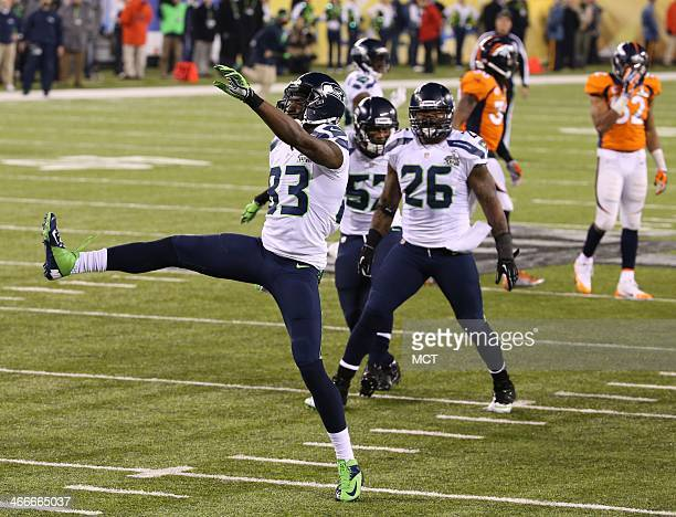 Ricardo Lockette of the Seattle Seahawks celebrates after making a tackle on special teams against the Denver Broncos in the second half of Super...