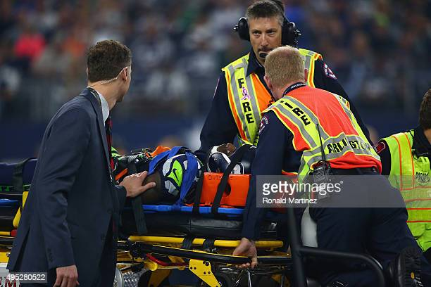 Ricardo Lockette of the Seattle Seahawks is taken off the field after an injury in the second quarter against the Dallas Cowboys at ATT Stadium on...