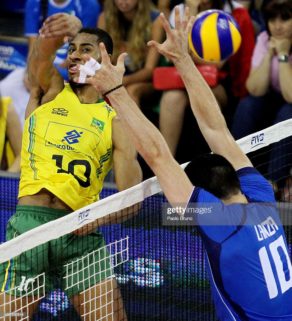 Ricardo Lucarelli of Brazil spikes the ball as <a gi-track='captionPersonalityLinkClicked' href=/galleries/search?phrase=Filippo+Lanza&family=editorial&specificpeople=11673393 ng-click='$event.stopPropagation()'>Filippo Lanza</a> of Italy blocks during the FIVB World League Final Six semifinal match between Italy and Brazil at Mandela Forum on July 19, 2014 in Florence, Italy.