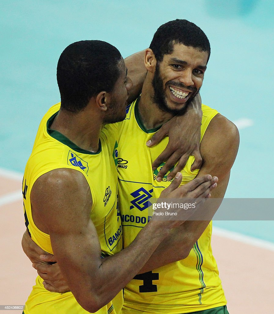 Ricardo Lucarelli (R) with his teammate of Brazil celebrate during the FIVB World League Final Six match for the first place between United States and Brazil at Mandela Forum on July 20, 2014 in Florence, Italy.