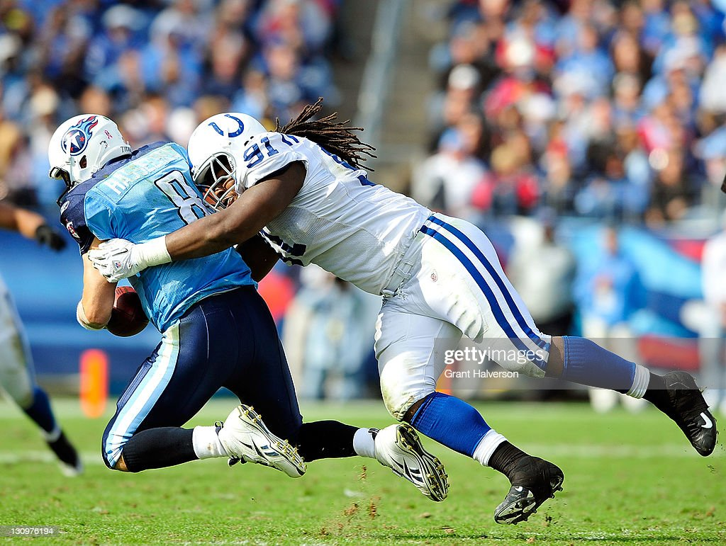 Ricardo Mathews of the Indianapolis Colts sacks quarterback Matt Hasselbeck of the Tennessee Titans during play at LP Field on October 30 2011 in...