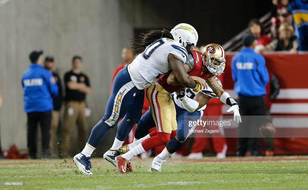 Ricardo Mathews of the San Diego Chargers sacks Colin Kaepernick of the San Francisco 49ers forcing a fumble during the game against the San...