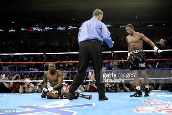 Ricardo Mayorga watches as Vernon Forrest slips to the canvas while referee Jay Nady steps in during their WBA/WBC Welterweight Championship fight at...