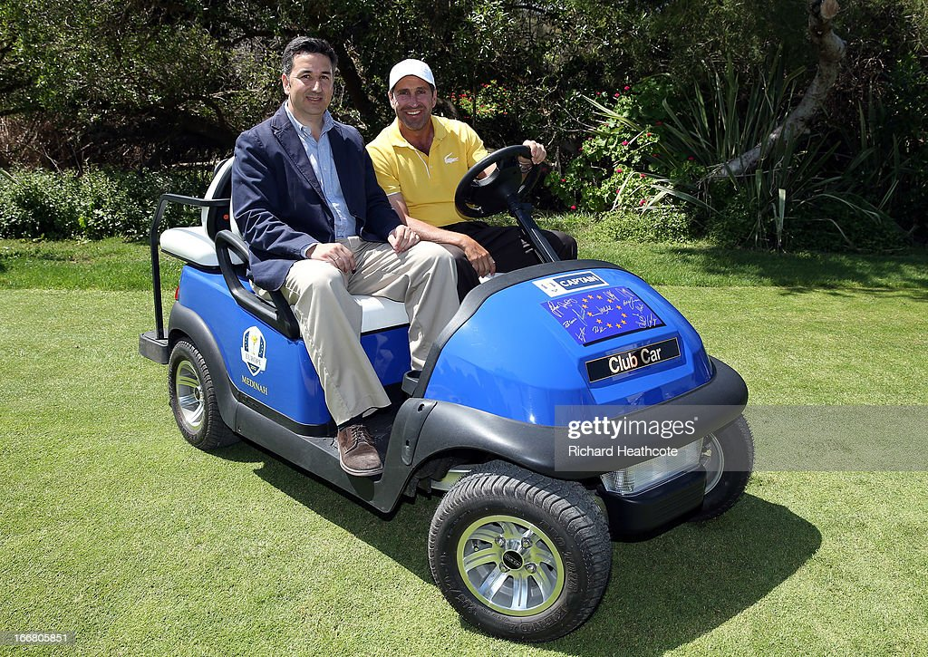 Ricardo Muelas, regional sales manager for Club Car presents former European Ryder Cup Captain <a gi-track='captionPersonalityLinkClicked' href=/galleries/search?phrase=Jose+Maria+Olazabal&family=editorial&specificpeople=176521 ng-click='$event.stopPropagation()'>Jose Maria Olazabal</a> with his signed Captains buggy at the Open de Espana at Parador de El Saler on April 17, 2013 in Valencia, Spain. All the victorious European players have signed the front of the cart for Jose Maria to keep.