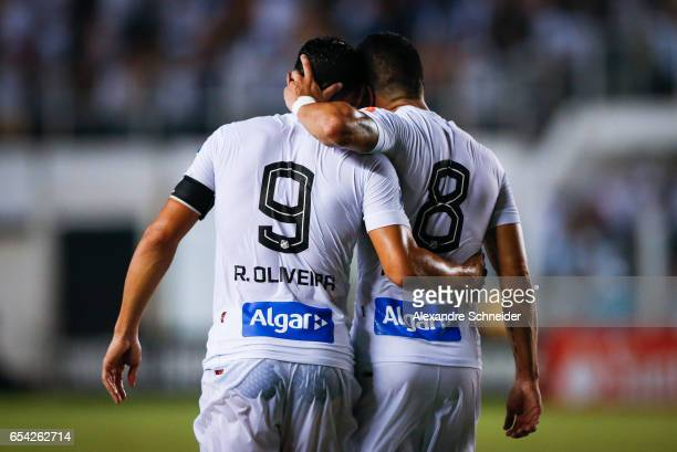 Ricardo Oliveira and Renato of Santos celebrate their secoond goal during the match between Santos of Brazil and The Strongest of Bolivia for the...