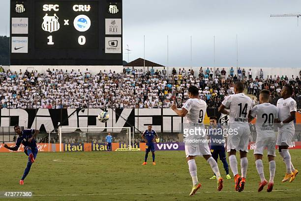 Ricardo Oliveira David Braz Lucas Lima and Chiquinho of Santos jumps in the wall during a free kick of Marquinhos of Cruzeiro during the match...