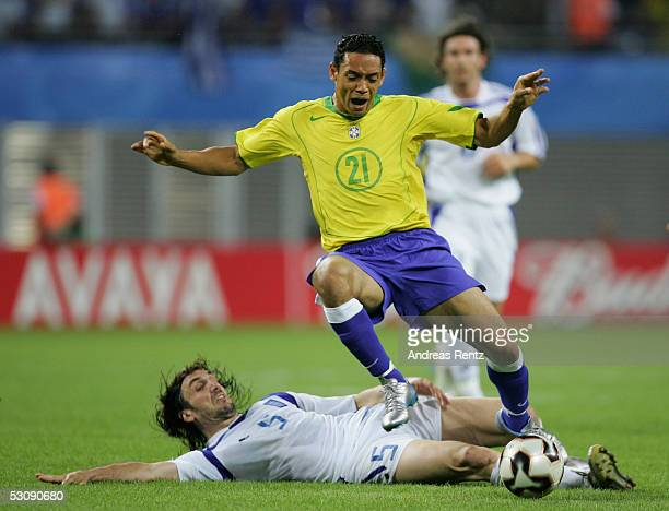 Ricardo Oliveira of Brazil challenges with Sotirios Kyrgiakos of Greece during the FIFA Confederations Cup 2005 match between Brazil and Greece on...