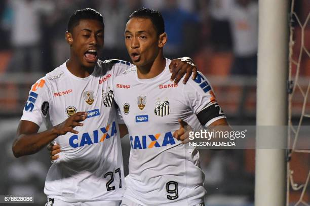 Ricardo Oliveira of Brazils Santos celebrates his goal against Colombias Santa Fe with teammate Bruno Henrique during their 2017 Copa Libertadores...