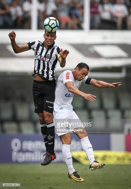 Ricardo Oliveira of Santos battles for the ball with Leonardo Silva of Atletico Mineiro during the match between Santos and Atletico Mineiro as a...