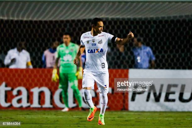 Ricardo Oliveira of Santos celebrates after scoring their first goal of Santos celebrate their first goal during the match between Santos of Brazil...