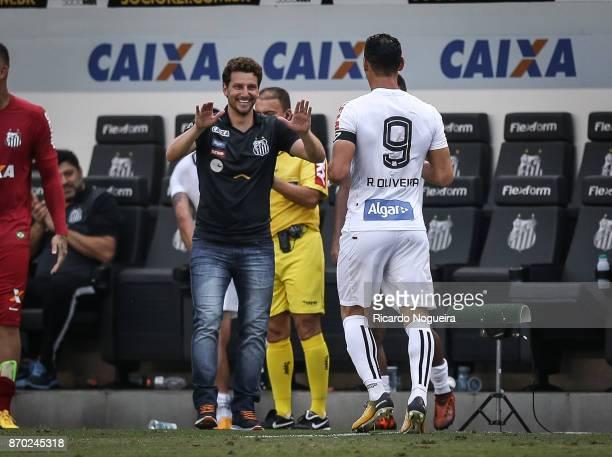 Ricardo Oliveira of Santos celebrates his goal with headcoach Elano of Santos during the match between Santos and Atletico Mineiro as a part of...