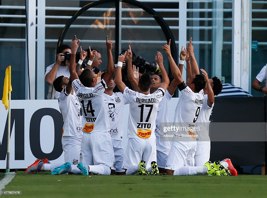 Ricardo Oliveira of Santos celebrates their first goal during the match between Santos and Corinthians for the Brazilian Series A 2015 at Vila...