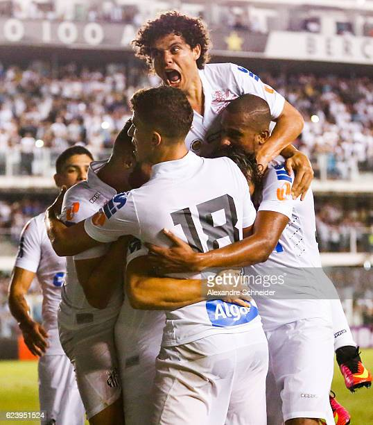 Ricardo Oliveira of Santos celebrates their second goal with his team mates during the match between Santos and Vitoria for the Brazilian Series A...